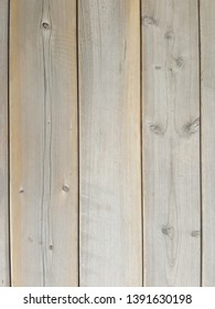 Close up of grey brown weathered wooden wall, floor, or signage boards - textured background.