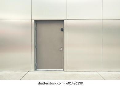 close grey door with aluminium or steel wall vintage filter