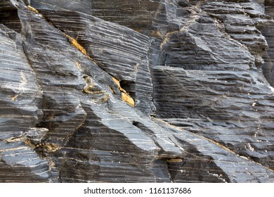 Close up of grey rock face texture with natural markings