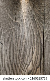 Close up of grey wooden planks with scratches, crackes and natural wooden pattern. Abstract texture background