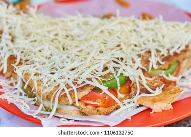 Close up of a grilled veggie sandwich with cheese.