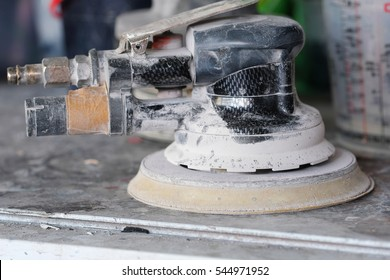 Close up grinder used in the body shops of the car repair stations