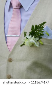 Close up of a groom's suit.