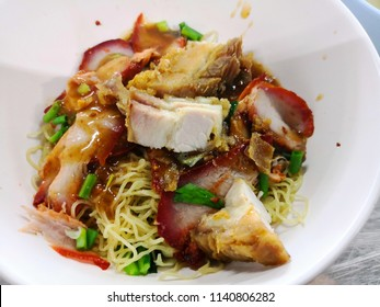Close up groumet Tomyum noodle with pork. Thai food style with filter effect