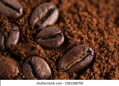Close up of ground coffee beans and coffee beans background.