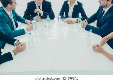 Close up of group of business people sitting around table at meeting
