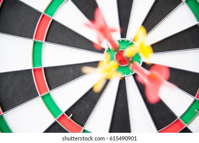 Close group of dart on target board