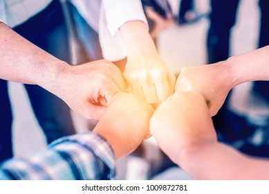 Close up  group of diversity business people fist bump,close fisted high five to succesful of team for trust in teamwork, teamwork together concept.