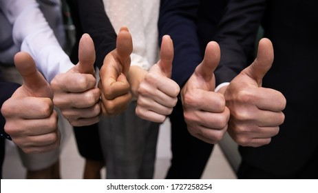 Close up group of multinational businesspeople standing in row showing to camera thumbs up gesture, concept of best recommendations, good choice, succeed common business goal, great result of teamwork