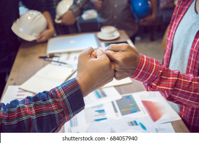 Close up group of peoples joining hands for starting joint business, common goal, successful team building, motivated enthusiastic co-workers starting work on project, running company together