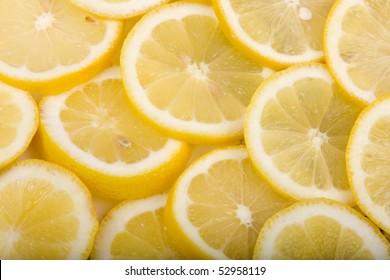 Close up of a group of sliced lemons citrus fruit.