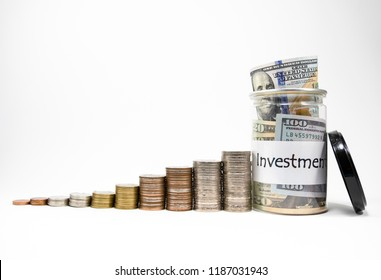 Close up growing of coins stacking and dollar banknote in pot with isolated white background for financial profit saving and investment concept. This is value investor.