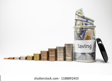 Close up growing of coins stacking and dollar banknote in jar with isolated white background for financial profit saving and investment concept. This is value investor.