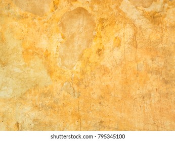 Close up grungy orange cement wall texture background