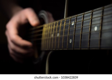 Close up of an guitar being