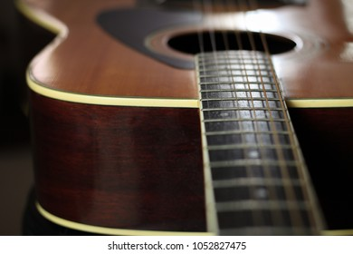 Close up of guitar neck and strings