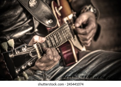 close up of a guitar player in hdr tone mapping
