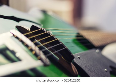 Close up of guitar strings.  A close up and abstract shot of an acoustic guitar strings.