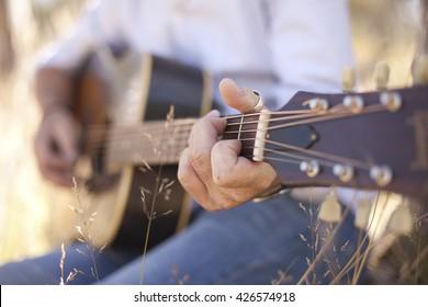 Close up of guitarist