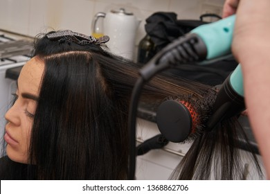 Close Up of Hair Styling With Hair Dryer and Brush