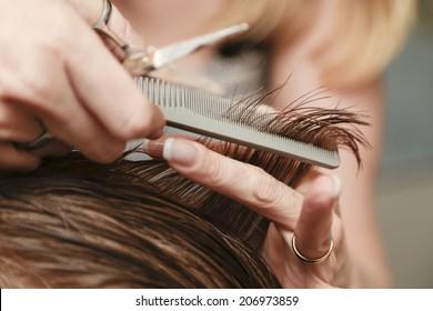 Close up of a haircut at a hair saloon