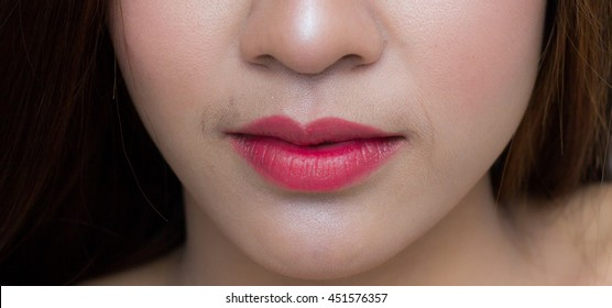 close up half face down lips and nose asian female portrait