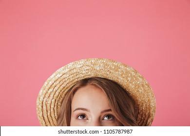 d5aee8935ffba Close up half face portrait of a happy young woman in straw hat looking up  isolated