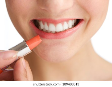 Close up half face young woman smiling with lipstick