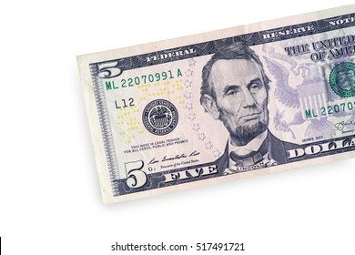 Close up of half five dollar isolate on white background with clipping path.