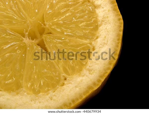 Close up of half a lemon on black background
