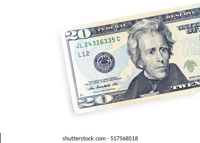 Close up of half twenty dollar isolate on white background with clipping path.