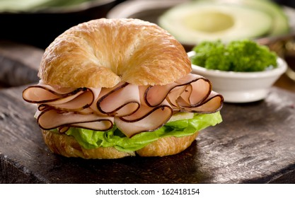 Close up of ham and cheese croissant sandwich.