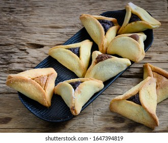 Close up of Hamantaschen cookies or hamans ears for Jewish festival of  Purim. Selective focus.