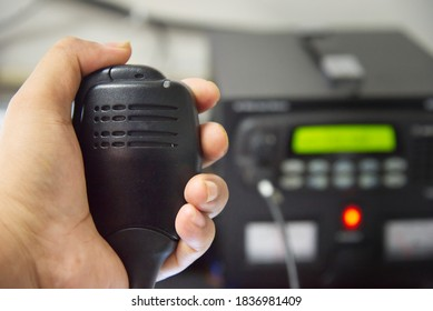 Close up of hand  Amateur holding speaker in base station.