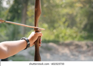 Close up hand of Asian Male Soldier training with the arror and bow