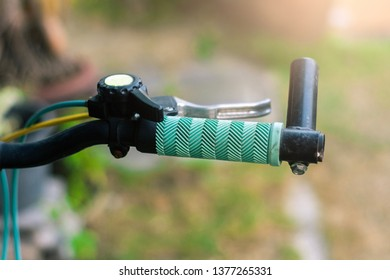 Close up hand brake mountain bike handle caliper bicycle blurred tree background for Exercise for health image
