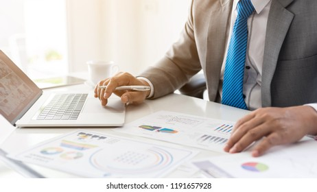 close up hand of  Business man consulting busy at office desk  on  Notebook and documents  working  , business concept