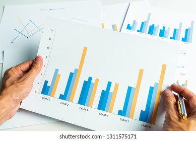 Close up hand of business man with financial report accounting analysis.