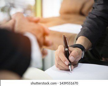 Close up hand of  business man sign a contract investment professional document agreement in the office,top view image