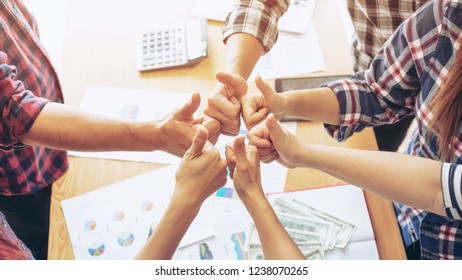 close up hand of business partnerships people bump hands thumb up finishing up meeting showing unity , business partner teamwork concept