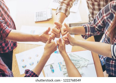 close up hand of business  people bump hands thumb up finishing up meeting showing unity , business teamwork concept