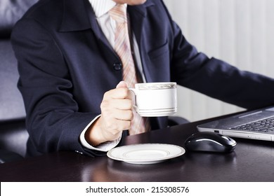 Close up hand of Businessman holding cup of coffee