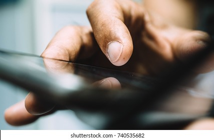 close up hand of businessman touching smart phone on social media