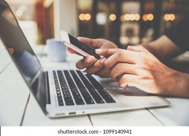 Close up hand of  businessman using cellphone for connecting and work with laptop. business people and technology concept.