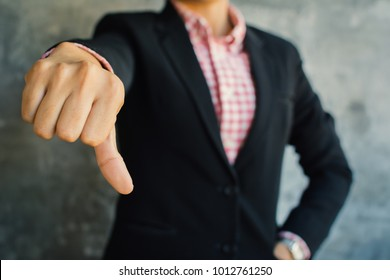 Close up of hand businesswoman thumb down  on loft background