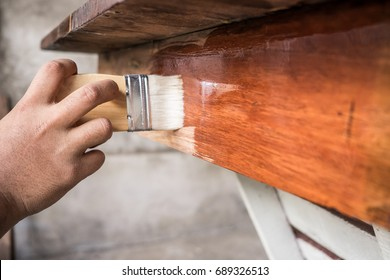 Close up hand carpenter working in workshop.