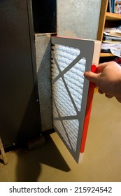Close up of hand changing home furnace filter
