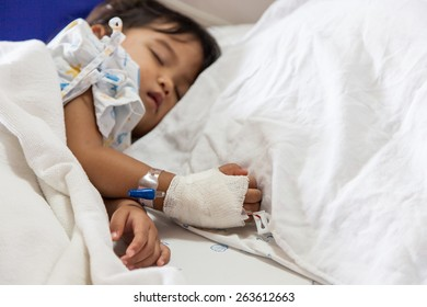 Close up of hand children sick sleeping on the bed at the hospital