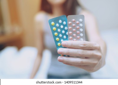 Close up  hand contraceptive pill on with colorful pills strips. Contraception reduces childbirth and pregnant concept.