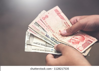 Close up of hand counting Indian rupee notes India